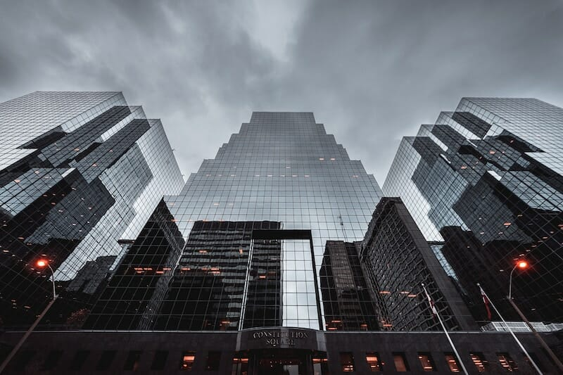 Modern Buildings with Reflections and Grey Sky
